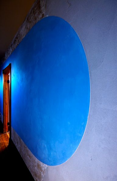 On the right side of the back hall. The blue shape is pigmented lime plaster.